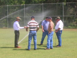 an image of irrigation students out on a field, listening to a lecture.